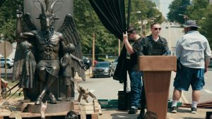 Lucien Greaves delivering a speech in front of the state capitol building in Little Rock, AR in HAIL SATAN?, a Magnolia Pictures release. Photo courtesy of Magnolia Pictures.